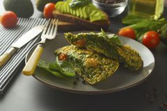 Omelet with spinach leaves. Healthy omelette for lose weight. Healthy food. Breakfast, dark, background, omlette, dinner, egg, lunch, meal, appetizer, cooked stock images