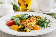Omelet with spinach Stock Images
