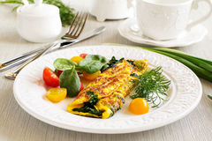 Omelet with spinach. And lettuce tomato stock photography
