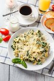 Omelet with spinach. And cheese on a white plate, coffee and orange juice on a white wooden table. Serving for breakfast stock photography