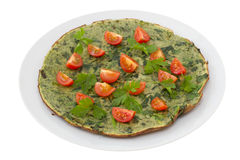 Omelet with spinach, parsley and tomato Royalty Free Stock Photo