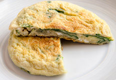 Omelet with spinach Stock Photos