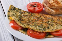 An omelet with spinach and tomatoes. Royalty Free Stock Photo