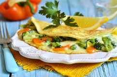 Omelet stuffed with broccoli,cheese and sweet pepper. Royalty Free Stock Image