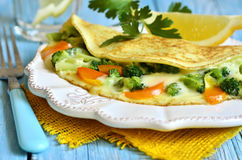Omelet stuffed with broccoli,cheese and sweet pepper. Stock Photos