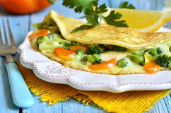 Omelet stuffed with broccoli,cheese and sweet pepper. Stock Image