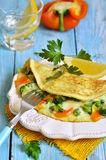 Omelet stuffed with broccoli,cheese and sweet pepper. Stock Photography