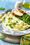 Omelet stuffed with green pea and mint. Royalty Free Stock Photos