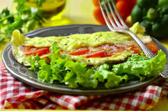 Omelet stuffed with tomatoes and cheese. Royalty Free Stock Photos