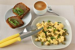 Omelet with toasts and coffee Stock Images