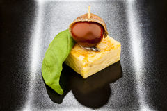 Omelet, tomato and anchovy pintxo with basil. Typical Spanish pintxo for the aperitive or light meal Stock Photo