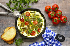 Omelet with tomatoes and asparagus bean. Stock Photo