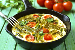 Omelet with tomatoes and asparagus bean. Royalty Free Stock Photo