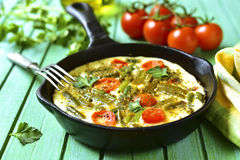 Omelet with tomatoes and asparagus bean. Stock Photos