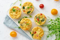 Omelet with tomatoes and bacon, baked eggs with spinach and broccoli, top view, keto, ketogenic diet.  royalty free stock image