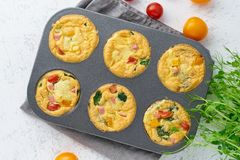 Omelet with tomatoes and bacon, baked eggs with spinach and broccoli, top view, keto, ketogenic diet.  royalty free stock photo