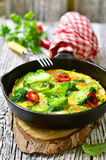 Omelet with tomatoes and broccoli. Royalty Free Stock Photos