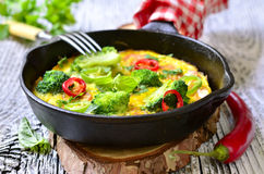 Omelet with tomatoes and broccoli. Royalty Free Stock Photography