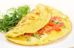 Omelet with tomatoes and herbs Royalty Free Stock Images