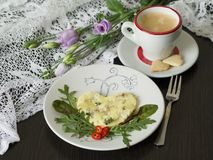 Omelet with tuna and green salad, cup of coffee with cookies in the shape of a heart against the background of delicate flowers. stock photo