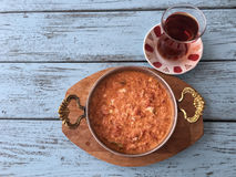 Omelet and turkish tea on wooden table Royalty Free Stock Photography