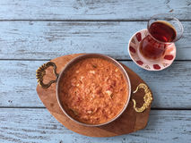 Omelet and turkish tea on wooden table Stock Photography
