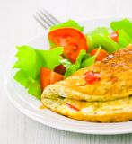 Omelet with vegetable salad Stock Photos
