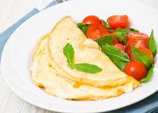 Omelet with vegetable salad Stock Images