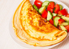 Omelet with vegetable salad Royalty Free Stock Photography