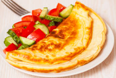 Omelet with vegetable salad Stock Image
