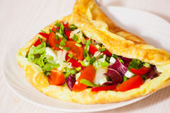 Omelet with vegetable salad Royalty Free Stock Image