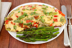 Omelet with vegetables and asparagus Stock Photography