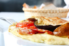 Omelet with vegetables and bacon Royalty Free Stock Images