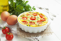 Omelet with vegetables and cheese. Frittata Stock Image
