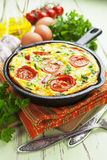 Omelet with vegetables and cheese. Frittata Royalty Free Stock Images