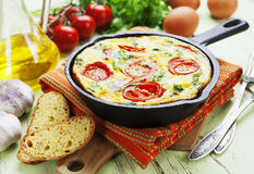 Omelet with vegetables and cheese. Frittata Royalty Free Stock Photo