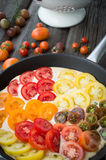 Omelet with vegetables and cheese. Frittata in a frying pan. And plate stock photo