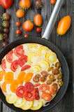 Omelet with vegetables and cheese. Frittata in a frying pan Royalty Free Stock Images