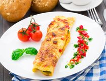 Omelet with vegetables and herbs Stock Photo