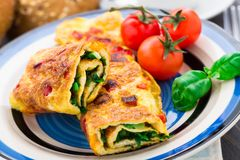 Omelet with vegetables and herbs Royalty Free Stock Photos