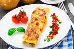 Omelet with vegetables and herbs Stock Images