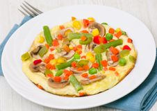 Omelet with vegetables and mushrooms Royalty Free Stock Photos