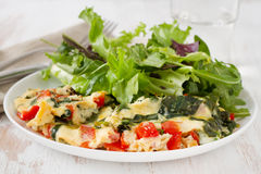 Omelet with vegetables and salad Stock Images