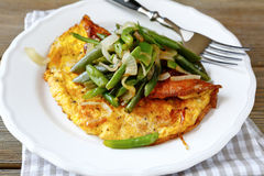 Omelet on a white plate Stock Photo