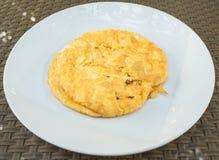 Omelet on white plate. Omelet set on white plate for breakfast Stock Image