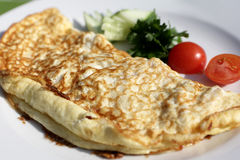 Omelet on white plate Stock Photography