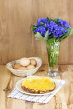 Omelet on wooden table royalty free stock photography