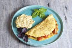 Omeleta do tomate e do atum Imagem de Stock