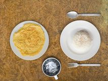 Omelete and rice Thai simple meal. Top view of Cheap and simple but delicious meal of Thai omelete and rice royalty free stock images