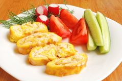 Omelete roulette. Omelet roulette stuffed with chicken fillet and some vegetables Stock Image